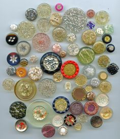 SOLD: 64 buttons with glitter $19.00