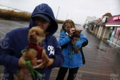 Battling the wind and rain while watching the ocean as Hurricane Sandy approaches at Rehoboth Beach, Del., Oct. 28, 2012. The computer models forecasting the track of Hurricane Sandy over the next three days are converging upon a landing around southern New Jersey that could create record coastal flooding and a big enough storm surge that state and local officials have ordered mandatory and voluntary evacuations along the coast from Delaware to Connecticut. (Luke Sharrett/The New York Times)