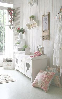 shabby chic...I could cut the heart out of the door of an old piece of furniture and put                 a piece of mesh wire where the heart is. I would then put a piece of shabby chic fabric over the wire. Of course this is done on the inside of the door.