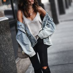 oversized denim jacket with silky tank and black distressed denim.