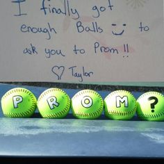 Use basketballs instead. Spell out PROM? with construction paper and tape to the balls. The guy should hold PR on one side and OM on the other. The question mark should be on the ground between his feet. Perfect for soccer or basketball players!