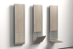 The Slice hydronic radiator provides exceptional radiant heat to your home, while adding style, efficiency, and added functionality with its convenient hideaway seat. Folding Furniture, Furniture Design, Wooden Hinges, Radiant Heaters, Small Entrance, Folding Seat, Yanko Design, Room Planning, Cool Gadgets