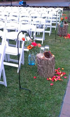I like the colors of the flowers and mason jar idea but not the log stumps.