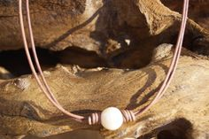Peal and Leather Necklace - Single Pearl Necklace - Lariat Necklace by Ginaspearls on Etsy https://www.etsy.com/listing/240652740/peal-and-leather-necklace-single-pearl