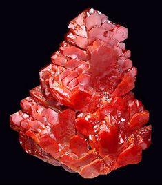 Reddish-orange vanadinite from Mibladen, Midelt, Meknès-Tafilalet Region, Morocco.  Measures 6.2 cm by 5.2 cm in size with 1 repair.  Ex. Matthew Webb Collection