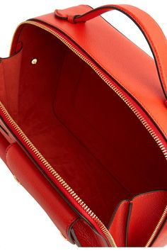 Tomato-red leather (Sheep) Zip fastening along top and sides Designer color: Coral Red Weighs approximately 1.8lbs/ 0.8kg Made in Italy