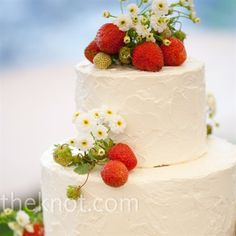 The four-tiered cake was decorated with strawberries and covered in buttercream for a just-frosted look.