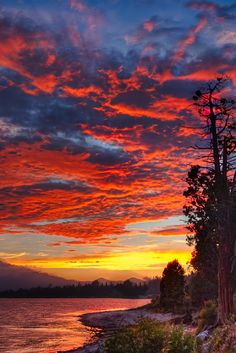 Sunset over Big Bear Lake, California. Big Bear Lake is located in the San Bernardino Mountains, and surrounded by the San Bernardino National Forest.