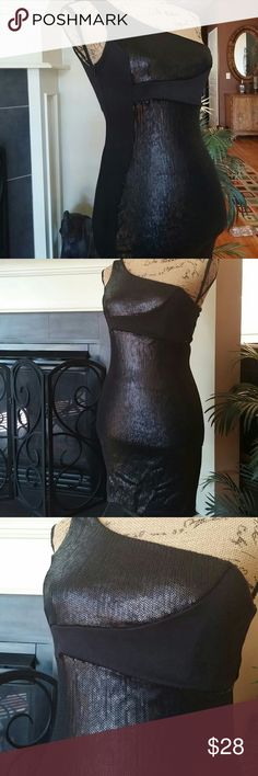 Classy chic black asymmetric dress Beautifully stunning is this black one shoulder dress. Has lovely black sequins on the front. Side zip. Beautiful cond. Polyester rayon spandex blend Mystic Dresses Asymmetrical