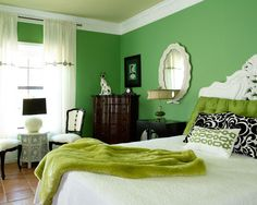 Color Psichology In Interior Design: Cool Green Color Bedroom Large Bed BlackWhite Pillow Green Bedcover Wood Chest Of Drawer White Frame Mirror Chairs Unique Table Curtain Standing Lamps ~ moabc.net Amazing Home Designs Inspiration