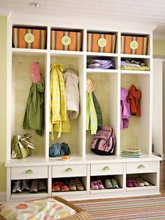Welcome Sight  Add flair to an entry using wallpaper. Here, open locker cubbies transform the entry and make it easy for the whole family to access and organize gear. Pretty wallpaper lines the backs of the lockers for style and dimension.