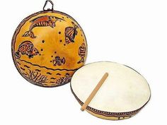 """Ocean Gourd Drum - Jamtown World Instruments. Decorated with fish by artisans using traditional burning techniques, this 10-inch diameter handmade gourd drum with goat skin includes a drumstick and playing instructions. Rolling the drum produces sounds similar to waves washing up on the shore. #SeaLife #OceanDrum #Drum  #MusicLovesFairTrade #DriedGourd #JamtownWorldInstruments  #10"""" Diameter"""