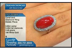 Beautiful ox blood red coral surrounded by diamonds in this estate ring in 18k white gold.