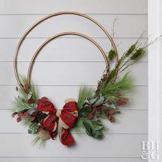 We are swooning over this large Christmas wreath made from two Hula-Hoops.
