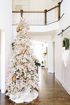 Flocked Christmas Tree The first thing people see through the front door when they approach our home during the holiday season is the 10 ft flocked Christmas tree in the foyer I love the way it fills our space with whites golds and browns a color pallet woven throughout our entire home Flocked Christmas Tree Flocked Christmas Tree Flocked Christmas Tree Flocked Christmas Tree Flocked Christmas Tree Color palette #FlockedChristmasTree #ChristmasTree #Colorpalette