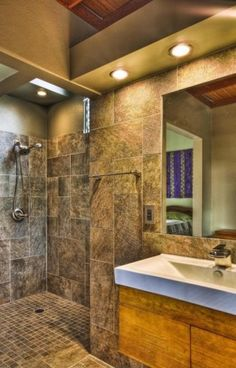 , Tropical Bathroom With Doorless Shower Designs Also Natural Tiling Wall Concept Also Modern Shower Head And Mixer Tap Also Modern Towel Rack Also Modern Mirror And White Washbasin Also Modern Faucet Design: Doorless Shower Designs for Your Bathroom