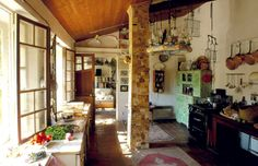 Bohemian kitchen interior > the space almost looks like a patio makeover addition to the original house