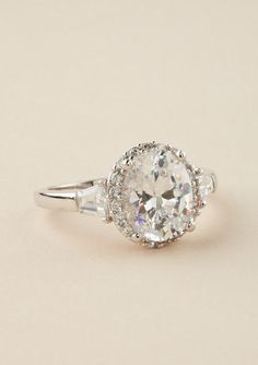 Wedding Wednesday | Lovely Rings Um HELLO! Halo, emerald and round!! Perfect for me :)
