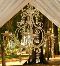 Beautiful cream Chandelier that doesnt use power but Candles or battery operate tea lights/Candles. So very elegant
