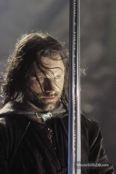 """Very bright was that sword when it was made whole again; the light of the sun shone redly in it, and the light of the moon shone cold, its edge was hard and keen. And Aragorn gave it a new name and called it Andúril, Flame of the West."" Viggo as Aragorn Viggo Mortensen, Gandalf, Legolas, Aragorn Lotr, O Hobbit, The Hobbit Movies, Fellowship Of The Ring, Lord Of The Rings, Narnia"