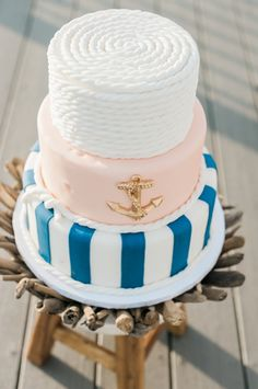 Nautical wedding cake idea - three-tier wedding cake with navy + white stripes, light pink + gold anchor, and white nautical rope top tier {Stephanie Barnes Photography}