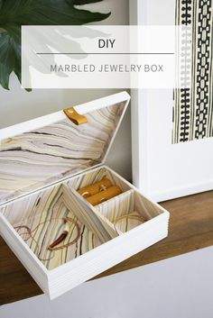 turn a lame cigar box into a beautiful marbled jewelry box using this tutorial