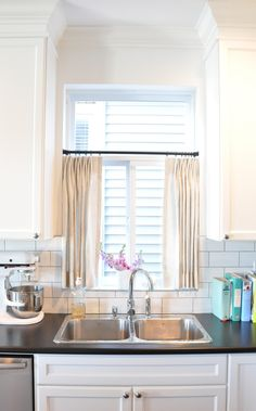 Love cafe curtains over a sink!