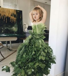 """Mom """"Dresses"""" Her Daughter In Food & Flowers  With the Use of Forced Perspective, The Internet Loves It  Alya Chaglar, an oil painter, and her three-year-old daughter Stefani play around with various leafy fruits and vegetable, using them to design elaborate costumes for the adorable little toddler."""
