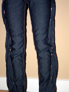 how to make skinny jeans...I remember doing this to my jeans in high school but we sewed it them on the inner seams. :)