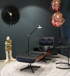 Eames Lounge Chair (Charles & Ray Eames, 1956) in combination with ClassiCon Adjustable Table E 1027 (Eileen Gray, 1927), Eames House Bird, Tom Dixon Melt TD Lights, Artemide Tolomeo Lettura (Michele De Lucchi & Giancarlo Fassina, 1986), Wall Clock (George Nelson, 1948-1960) and Artwork Sjer Jacobs