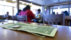"Liberal minimum wage activists shun tipping as ""racist"""