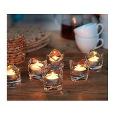 IKEA VÄSNAS tealight holder The clear glass reflects and enhances the warm glow of the candle-flame.