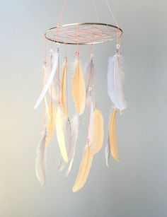 Feather Mobile, Baby Mobile, Dream Catcher Mobile, Peach and Gray Feather Mobile, Boho Mobile, Boho Nursery Mobile by goshandgolly on Etsy https://www.etsy.com/listing/449685630/feather-mobile-baby-mobile-dream-catcher