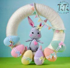 Guirnalda de Pascua con conejito y huevos guirnalda de