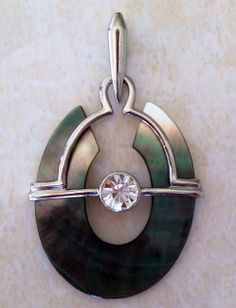 Shades of Gray Oval Pendant  Beautiful gray and silver toned pendant, with large cubic zirconia center.  A mystical piece reminiscent of Ancient Rome.