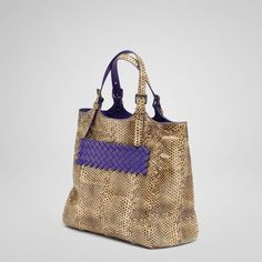 Bottega bag with a splash of purple, lined with purple... love it because you can carry it and it does not require a size!