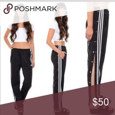 Adidas snap button pants Worn once! Black adidas pants with white strips and snap buttons down the side perfect condition size small adidas Pants Track Pants & Joggers