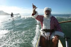 Christmas in Hawaii?  Yes, please! Santa in a canoe with a surfer in the background. You really can't beat this!
