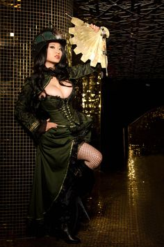 """Yaya Han""  Very Wild Wild West inspired. The movie, if nothing else, had some great costuming. #steampunk #fashion #western #model #woman #asian #oriental #fan #corset #victorian #goth #gothic #neovictorian"
