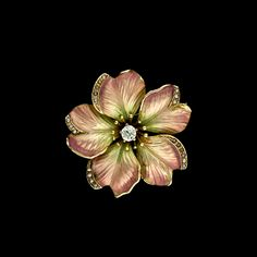 Beautifully crafed in 14 karat yellow gold this delightful art nouveau flower has petals colored with translucent peach to green enamel. The petals are delicately edges with very tiny seed pearls. The pin is centered with a prong set .15 carat mine cut diamond (VS clarity / OP color) surrounded by fine stamens of gold. Safety catch has been added. The pin can also be worn as a pendant as a bale swivels up for use and down to be hidden. Circa 1900. Condition: Very good. Measurements: 1 1/8…