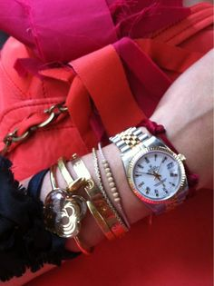 bangles, cartier love bracelet, and rolex all on one arm= yes, please