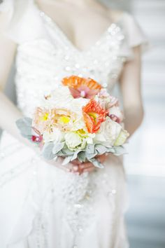 coral and orange bridal bouquet by Mimosa Flower Studio, photos by Tyler James Photography via JunebugWeddings.com