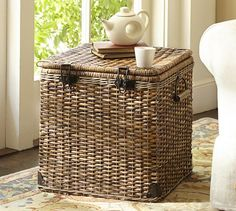 "Daytrip Lidded Cube Basket - inspired by vintage automobile trunks.      18"" square, 18.5"" high.     Made of handwoven split malacca and natural rattan."