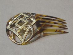 A tortoiseshell hair comb with diamonte decoration