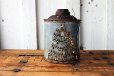 This listing is for an antique gas can that has been repurposed into a creative Christmas decoration!