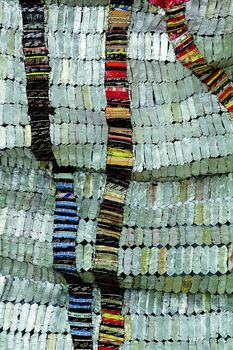 Nigerian artist El Anatsui ~ best known for shimmering tapestries made from liquor bottle tops,