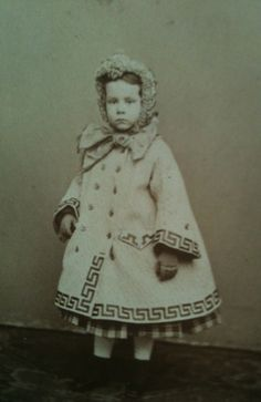 Young girl with fabulous greek key trimmed coat. 1860s. American.