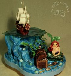 This Superb Ariel Cake was made byTatiana K. This Disney cake features Eric's ship and Ariel with her treasures untold. It's great the wa...