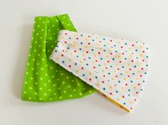 "Baby ""Infinity Scarf"" Drool Bibs. In Multicolour Polka Dots, on off- white background. Bright Yellow Dots lining. By Mommy Can Sew, on Etsy"