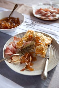 In a neat parcel of prosciutto, phyllo dough, and pear jam: | 23 Next-Level Ways To Make Baked Brie